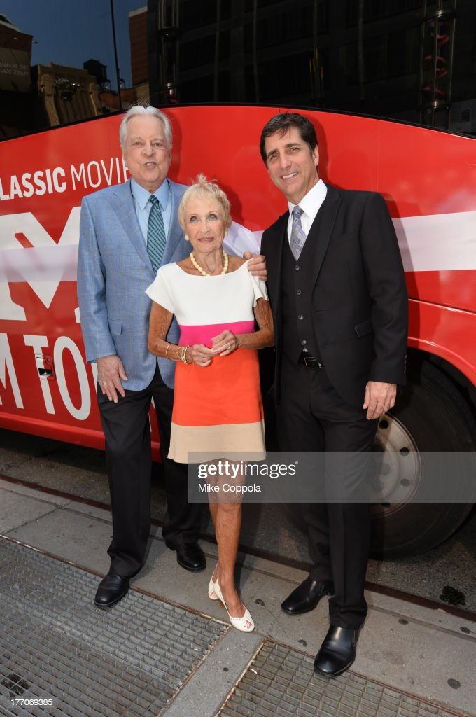 TCM host Robert Osborne (L) is joined by actress Jane Powell (C) and Dennis Adamovich (R), Senior Vice President of digital, affiliate, lifestyle and enterprise commerce, TCM, TBS and TNT to launch the 'TCM Classic Film Tour' on August 20, 2013 in New York City. Featuring stops at some of the most famous movie locations throughout the city, this sightseeing bus tour opens to the public Thursday, Aug. 22, running Tuesdays, Thursdays and Saturdays, beginning at 11:30 a.m. The three-hour sightseeing bus tour will take movie fans to some of the city's greatest filming locations, including the Empire State Building (King Kong); Zabar's market (Manhattan, You've Got Mail); Holly Golightly's brownstone (Breakfast at Tiffany's); the famed subway grate that blew Marilyn Monroe's skirt (The Seven-Year Itch); Grand Central Terminal (North by Northwest, Superman); and, of course, Central Park. (Photo by Mike Coppola/WireImage) 23987_004_MC_ 0031.JPG Robert Osborne; Jane Powell; Dennis Adamovich
