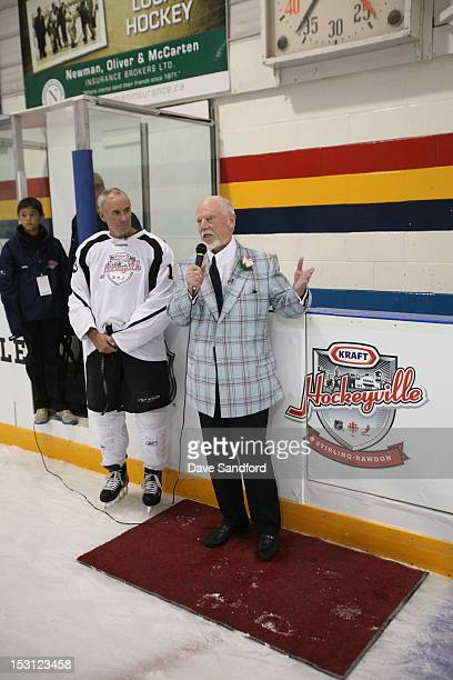 CBC host Ron MacLean speaks with Don Cherry during the Celebrity Hockey Game at the Stirling and District Recreation Centre during Kraft Hockeyville...