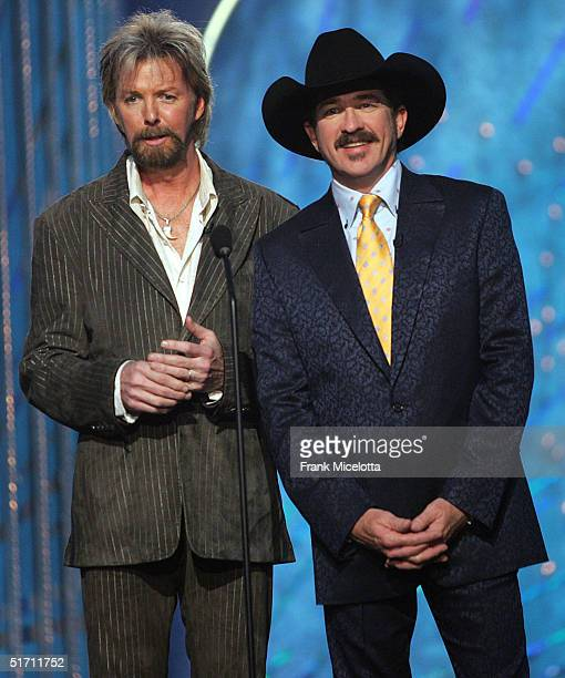 Host Ronnie Dunn and Kix Brooks of the country music duo Brooks Dunn speak on stage at the 38th Annual CMA Awards at the Grand Ole Opry House...