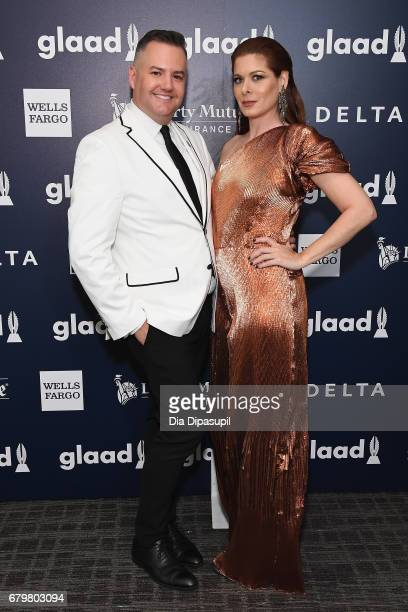 Host Ross Mathews and honoree Debra Messing pose backstage at the 28th Annual GLAAD Media Awards at The Hilton Midtown on May 6 2017 in New York City