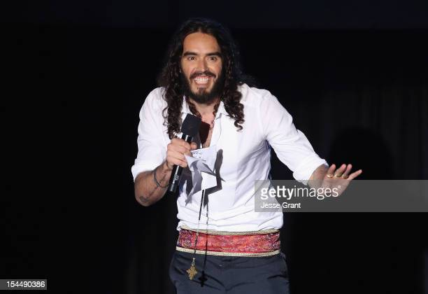 Host Russell Brand speaks onstage at The Motion Picture Television Fund Presentation of Reel Stories Real Lives at Milk Studios on October 20 2012 in...