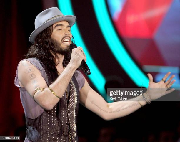 Host Russell Brand speaks onstage during the 2012 MTV Movie Awards held at Gibson Amphitheatre on June 3 2012 in Universal City California