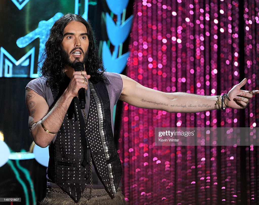 Host Russell Brand speaks onstage during the 2012 MTV Movie Awards held at Gibson Amphitheatre on June 3, 2012 in Universal City, California.