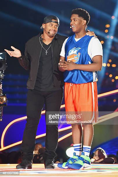 Host Russell Wilson and Jonathan Clark speak onstage at the Nickelodeon Kids' Choice Sports Awards 2015 at UCLA's Pauley Pavilion on July 16 2015 in...