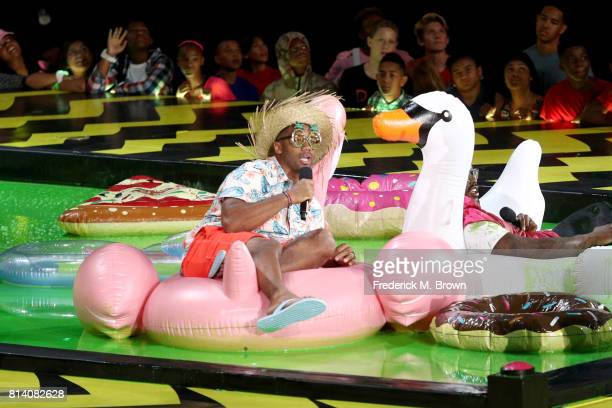 Host Russell Wilson and NFL player Von Miller onstage during Nickelodeon Kids' Choice Sports Awards 2017 at Pauley Pavilion on July 13, 2017 in Los...