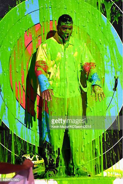 Host Russell Wilson gets slimed onstage at the Nickelodeon Kids' Choice Sports Awards 2015 at UCLA's Pauley Pavilion on July 16 2015 in Westwood...