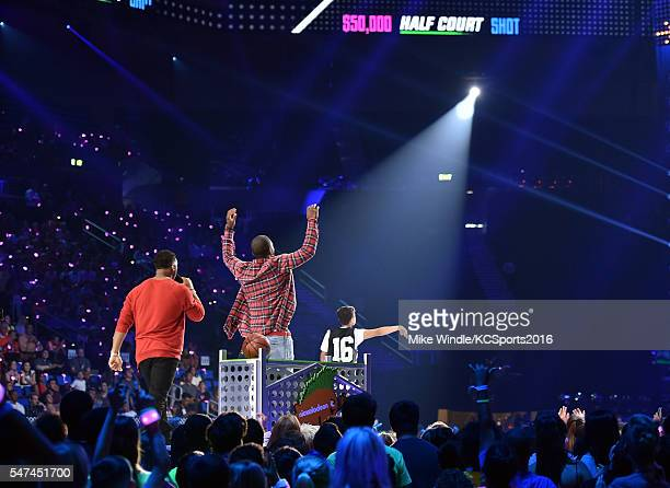 Host Russell Wilson, NBA player Kyrie Irving and $50K Triple Shot Challenge contestant Rey Fernandez speak onstage during the Nickelodeon Kids'...