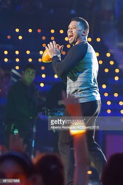 Host Russell Wilson onstage at the Nickelodeon Kids' Choice Sports Awards 2015 at UCLA's Pauley Pavilion on July 16 2015 in Westwood California