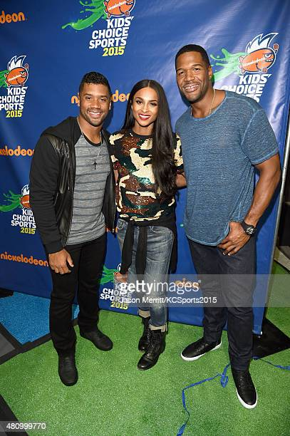 Host Russell Wilson, recording artist Ciara and TV host & former NFL player Michael Strahan attend the Nickelodeon Kids' Choice Sports Awards 2015 at...