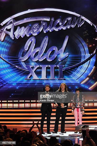 Host Ryan Seacrest American Idol finalists Caleb Johnson and Jena Irene speak onstage during Fox's American Idol XIII Finale at Nokia Theatre LA Live...