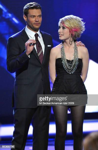 ACCESS*** Host Ryan Seacrest and contestant Alexis Grace onstage live at American Idol March 10 2009 in Los Angeles California The top 13 perform in...