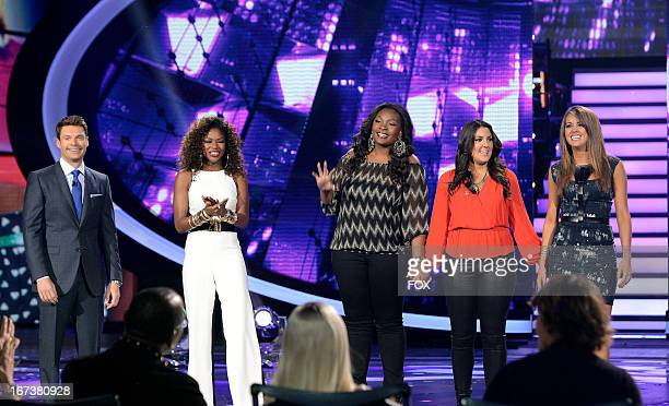Host Ryan Seacrest and contestants Amber Holcomb Candice Glover Kree Harrison and Angie Miller onstage at FOX's American Idol Season 12 Top 4 Live...