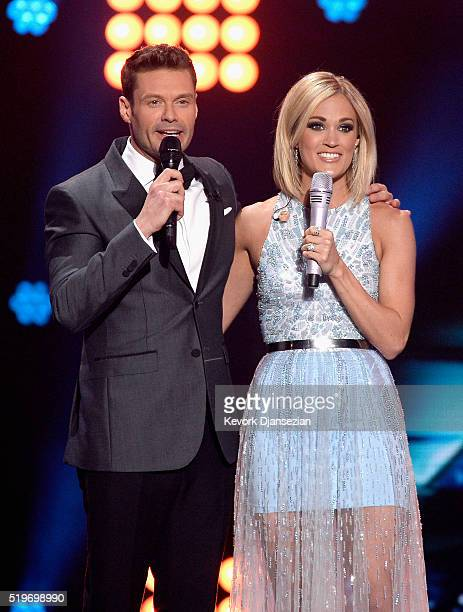 """Host Ryan Seacrest and recording artist Carrie Underwood speak onstage during FOX's """"American Idol"""" Finale For The Farewell Season at Dolby Theatre..."""