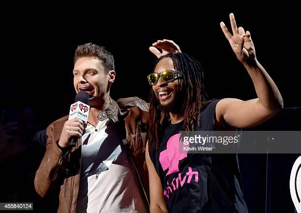 Host Ryan Seacrest and recording artist Lil Jon speak onstage during the 2014 iHeartRadio Music Festival at the MGM Grand Garden Arena on September...