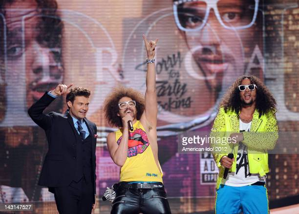 Host Ryan Seacrest and RedFoo and SkyBlu of LMFAO onstage at FOX's American Idol Season 11 Top 7 With Save To 6 Live Elimination Show on April 19...