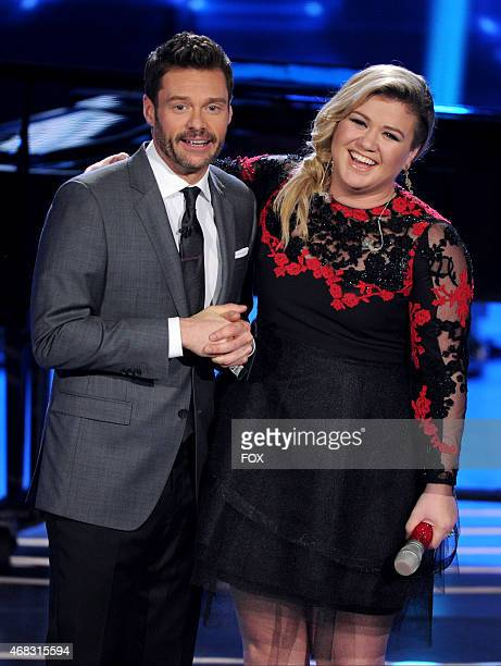 Host Ryan Seacrest and singer Kelly Clarkson onstage at FOX's 'American Idol XIV' Top 8 Revealed on April 1 2015 in Hollywood California