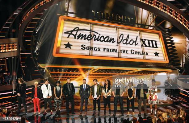 Host Ryan Seacrest and the top 11 contestants onstage at FOX's 'American Idol XIII' Top 11 Live Performance Show on March 12 2014 in Hollywood...