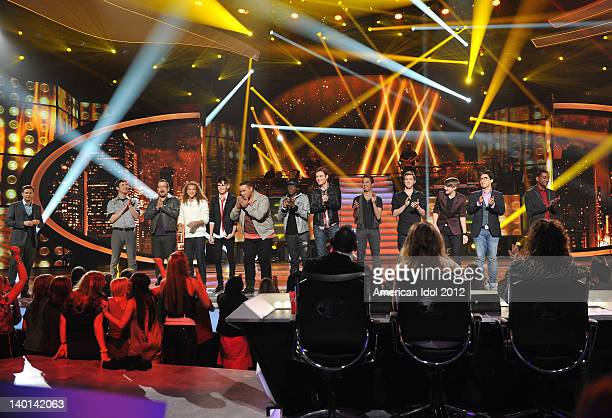 Host Ryan Seacrest and the top 13 guy contestants Reed Grimm Adam Brock DeAndre Brackensick Colton Dixon Jeremy Rosado Aaron Marcellus Chase Likens...