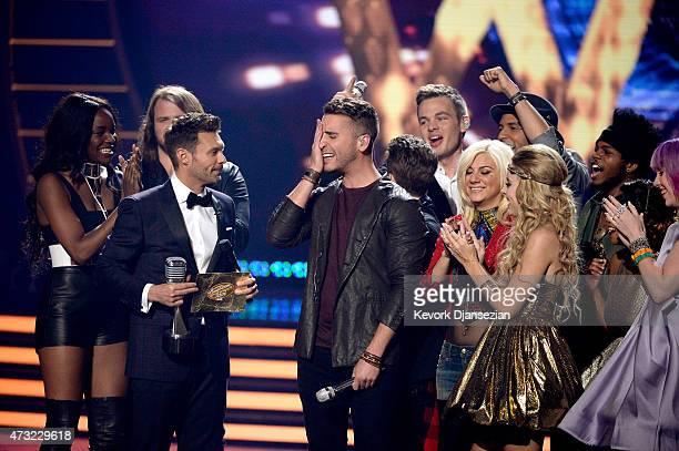 Host Ryan Seacrest announces the winner Nick Fradiani onstage with American Idol finalists Adanna Duru Qaasim Middleton Clark Beckham Rayvon Owen Jax...