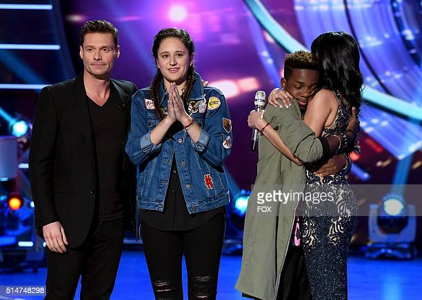 Host Ryan Seacrest, eliminated contestants Avalon Young and Lee Jean, and top 6 contestant Sonika Vaid onstage at FOX's American Idol Season 15 on...