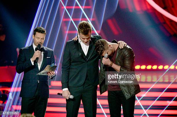 """Host Ryan Seacrest, finalists Clark Beckham and Nick Fradiani onstage during """"American Idol"""" XIV Grand Finale at Dolby Theatre on May 13, 2015 in..."""