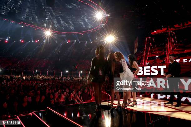 Host Ryan Seacrest listens as singers Normani Kordei Ally Brooke Dinah Jane and Lauren Jauregui of music group Fifth Harmony accept the Best Fan Army...