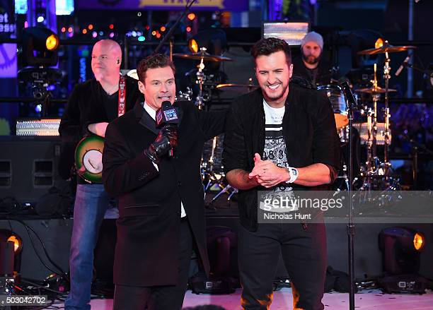Host Ryan Seacrest speaks on stage with singer Luke Bryan on New Year's Eve 2016 In Times Square at Times Square on December 31 2015 in New York City