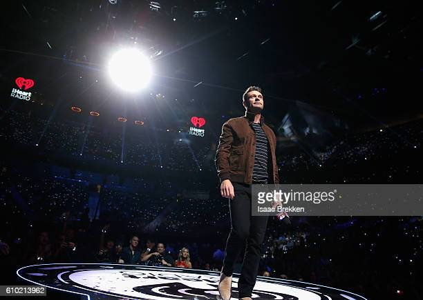 Host Ryan Seacrest speaks onstage at the 2016 iHeartRadio Music Festival at TMobile Arena on September 24 2016 in Las Vegas Nevada