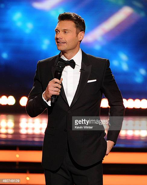 Host Ryan Seacrest speaks onstage during Fox's American Idol XIII Finale at Nokia Theatre LA Live on May 21 2014 in Los Angeles California