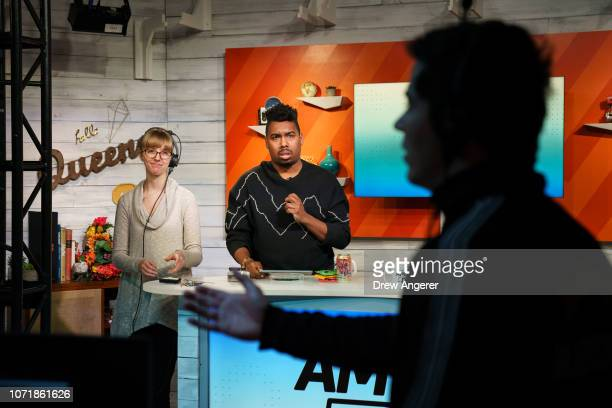 Host Saeed Jones confers with production staff before a live recording of of BuzzFeed News' AM To DM morning show at BuzzFeed headquarters December...
