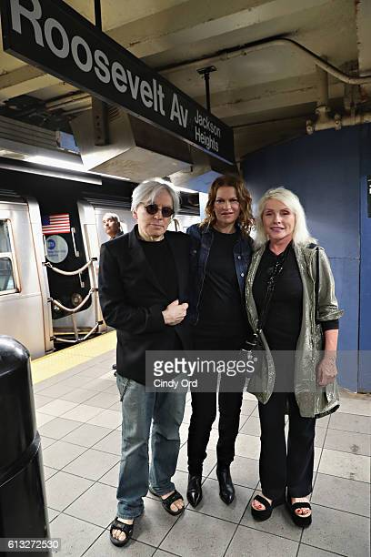 Host Sandra Bernhard poses for a photo in the Roosevelt Ave subway station with Chris Stein and Debbie Harry of Blondie during 'Sandyland' her...