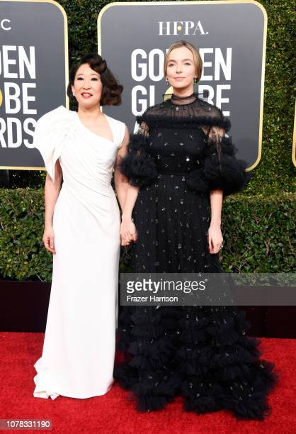 Host Sandra Oh and Jodie Comer attend the 76th Annual Golden Globe Awards at The Beverly Hilton Hotel on January 6 2019 in Beverly Hills California