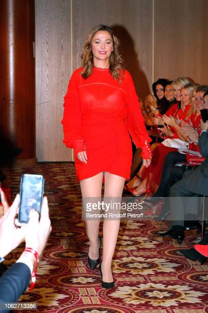 Host Sandrine Quetier dressed by Isabel Marant walks the runway during the Sauvez le Coeur des Femmes Red Defile Show at Hotel Marriot on November 16...