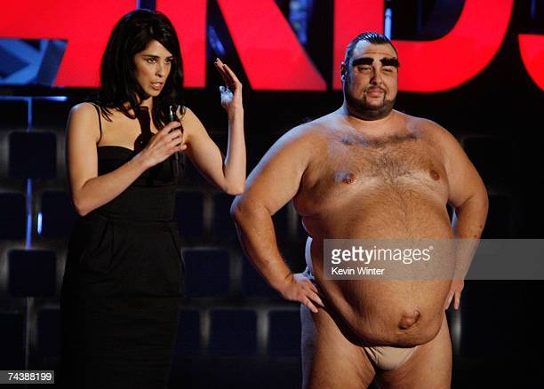 Host Sarah Silverman and a man portraying 'Azamat Bagatov' onstage during the 2007 MTV Movie Awards held at the Gibson Amphitheatre on June 3 2007 in...