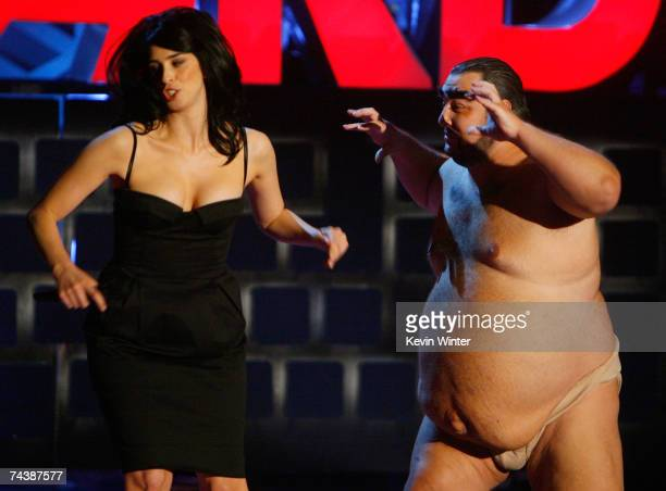 Host Sarah Silverman runs from a man portraying 'Azamat Bagatov' onstage during the 2007 MTV Movie Awards held at the Gibson Amphitheatre on June 3...