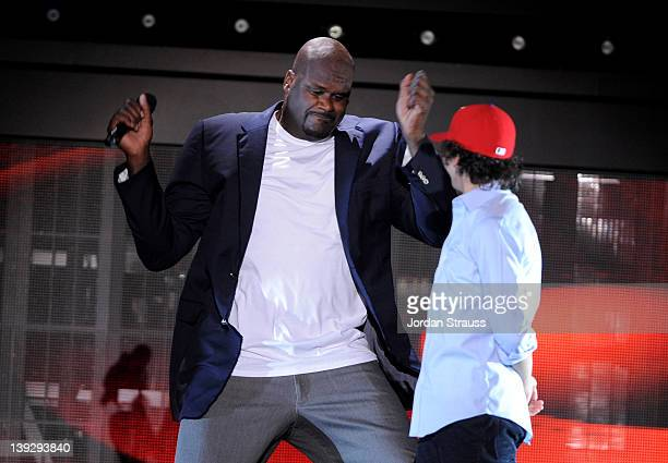 Host Shaquille O'Neal and dancer Adam Sevani perform onstage during the 2012 Cartoon Network Hall of Game Awards at Barker Hangar on February 18 2012...