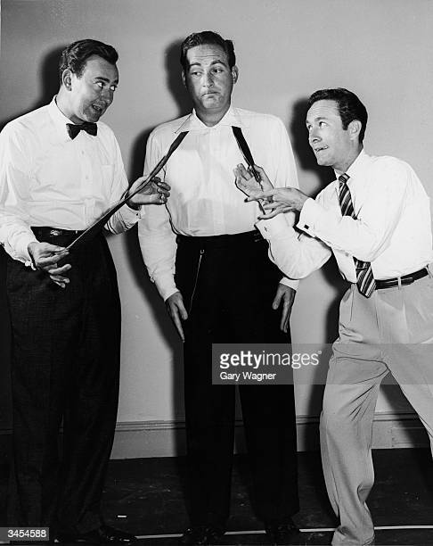 Host Sid Caesar stands still as Carl Reiner and Howard Morris pull opposite ends of his necktie in a promotional still for the TV comedy series 'Your...