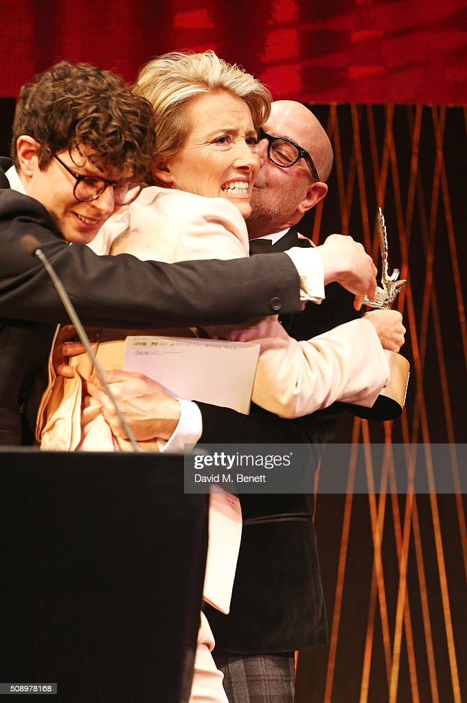 Host Simon Amstell, Emma Thompson, winner of the Comedy Award for 'The Legend Of Barney Thomson', and Stanley Tucci hug onstage at the London Evening Standard British Film Awards at Television Centre on February 7, 2016 in London, England.