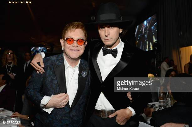 Host Sir Elton John and designer Hedi Slimane attend the 25th Annual Elton John AIDS Foundation's Academy Awards Viewing Party at The City of West...