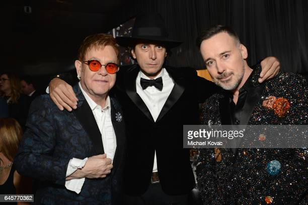 Host Sir Elton John, designer Hedi Slimane, and David Furnish attend the 25th Annual Elton John AIDS Foundation's Academy Awards Viewing Party at The...