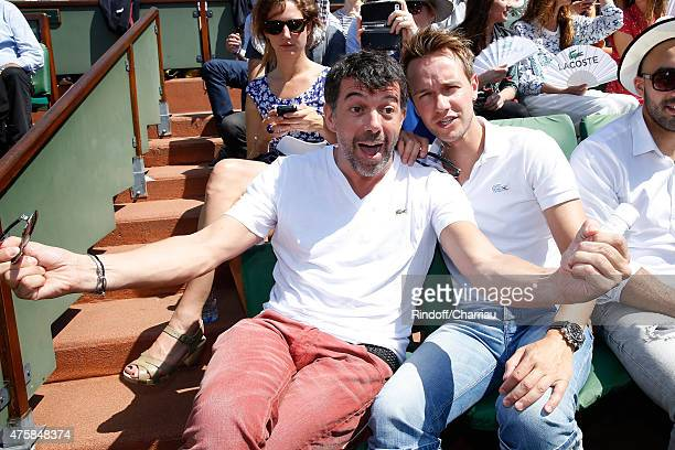 Host Stephane Plaza and Journalist Cyril Feraud attend the 2015 Roland Garros French Tennis Open - Day Twelve, on June 4, 2015 in Paris, France.
