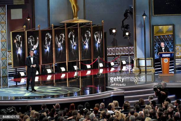 Host Stephen Colbert and Sean Spicer speak onstage during the 69th Annual Primetime Emmy Awards at Microsoft Theater on September 17 2017 in Los...