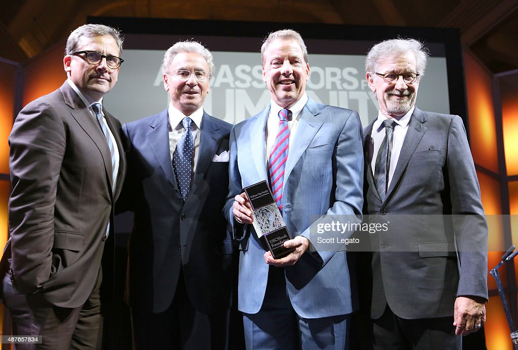 Host Steve Carell, USC Shoah Foundation board member Mickey Shapiro, honoree William Clay Ford, Jr. (holding Ambassador for Humanity Award) and USC Shoah Foundation founder Steven Spielberg pose onstage at the USC Shoah Foundation Ambassadors for Humanity Gala honoring William Clay Ford, Jr. at the Henry Ford Museum on September 10, 2015 in Dearborn, Michigan.