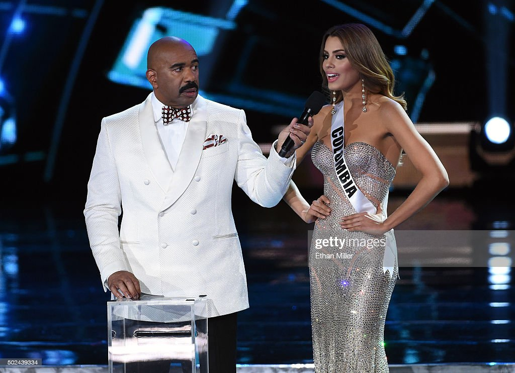Host Steve Harvey (L) listens as Miss Colombia 2015, Ariadna Gutierrez Arevalo, answers a question during the interview portion of the 2015 Miss Universe Pageant at The Axis at Planet Hollywood Resort & Casino on December 20, 2015 in Las Vegas, Nevada. Gutierrez went on to be named the first runner-up.