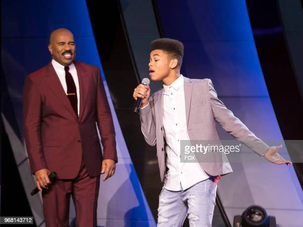 Host Steve Harvey with contestant Cam Anthony in the Finale season finale episode of SHOWTIME AT THE APOLLO airing Thursday May 24 on FOX