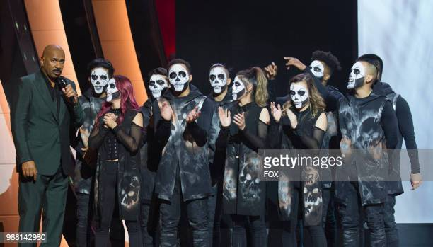 Host Steve Harvey with members of Academy Of Villians in the Week 8 episode of SHOWTIME AT THE APOLLO airing Thursday April 19 on FOX
