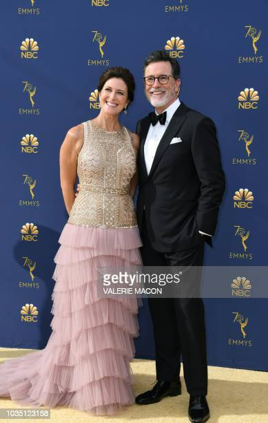 Host Steven Colbert and his wife Evelyn McGee-Colbert arrive for the 70th Emmy Awards at the Microsoft Theatre in Los Angeles, California on...