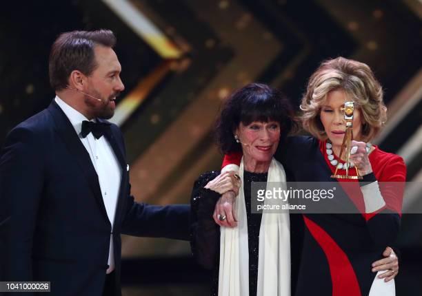 Host Steven Gaetjen and actress Geraldine Chaplin hands over the award in the category 'Lifetime Achievement International' for actress Jane Fonda...