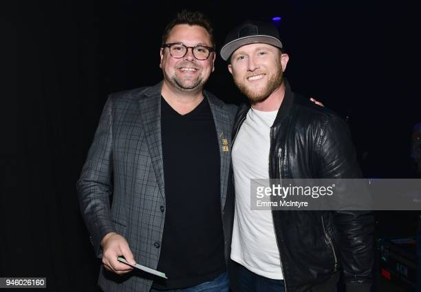 Host Storme Warren and Cole Swindell attend ACM Stories Songs Stars A Songwriter's Event Benefiting ACM Lifting Lives at The Joint inside the Hard...
