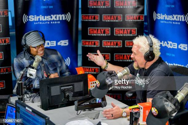 Host Sway Calloway with Guy Fieri as he visits Sways Universe to discuss his Chicken Guy sandwich at SiriusXM Studios on February 25 2020 in New York...